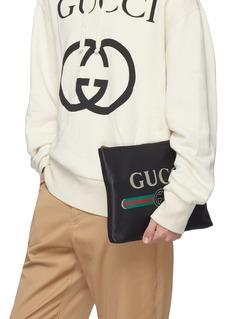 Gucci Logo print medium leather zip pouch