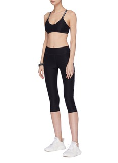 The Upside 'NYC' logo stripe outseam cropped compression leggings