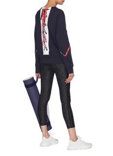 The Upside 'Bardot' logo ribbon lace-up back sweatshirt