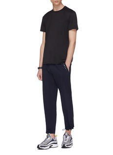 Particle Fever Pleated jogging pants
