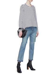 Sacai Let-out cuff ripped jeans