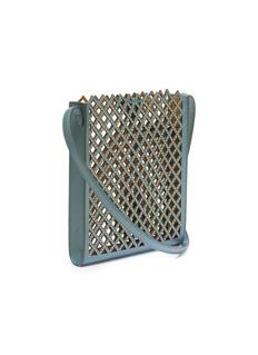Alaïa Micro stud diamond lasercut leather crossbody bag