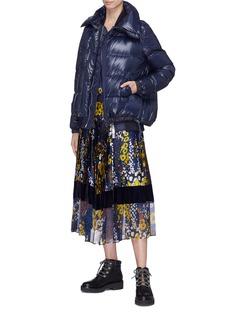 Sacai Asymmetric zip down puffer jacket