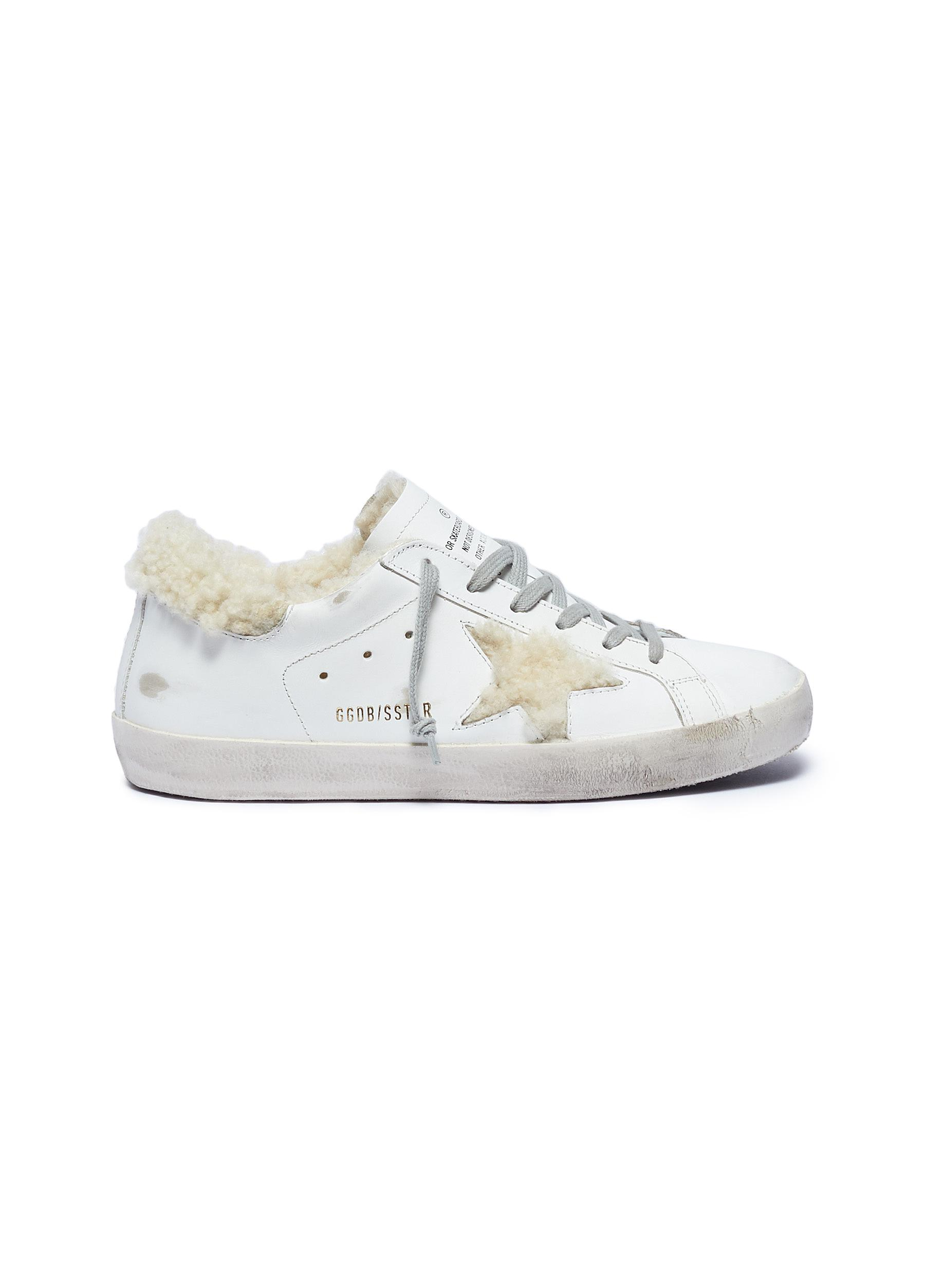 Superstar shearling lined leather sneakers by Golden Goose
