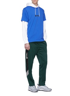 M+RC NOIR Logo stripe outseam track pants