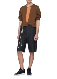SIKI IM / DEN IM Raw cuff herringbone Bermuda shorts