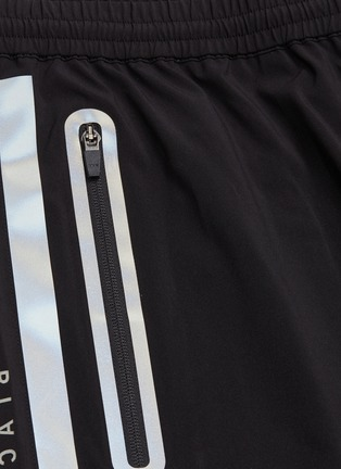 - BLACKBARRETT - Reflective stripe outseam track shorts