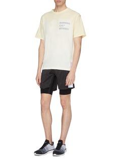 Satisfy 'Trail Long Distance' reflective slogan print layered paint splatter running shorts