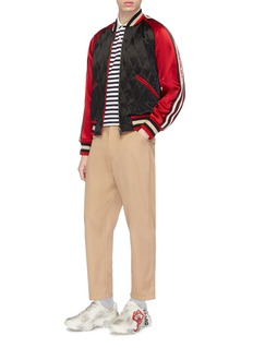 Gucci Mix motif embroidered stripe knit polo shirt