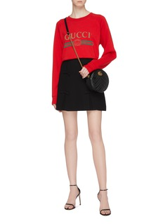 Gucci Sequinned graphic slogan oversized sweatshirt
