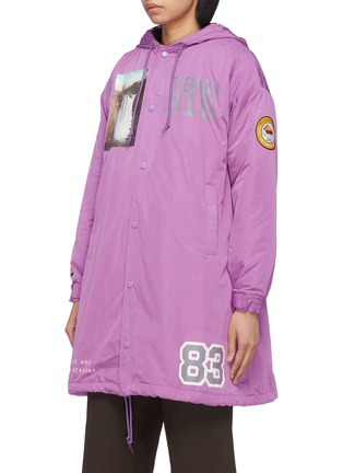 Front View - Click To Enlarge - UNDERCOVER - 'Former Juvenile' slogan graphic print hooded raincoat