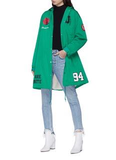UNDERCOVER 'We Are Infinite' slogan logo print padded raincoat
