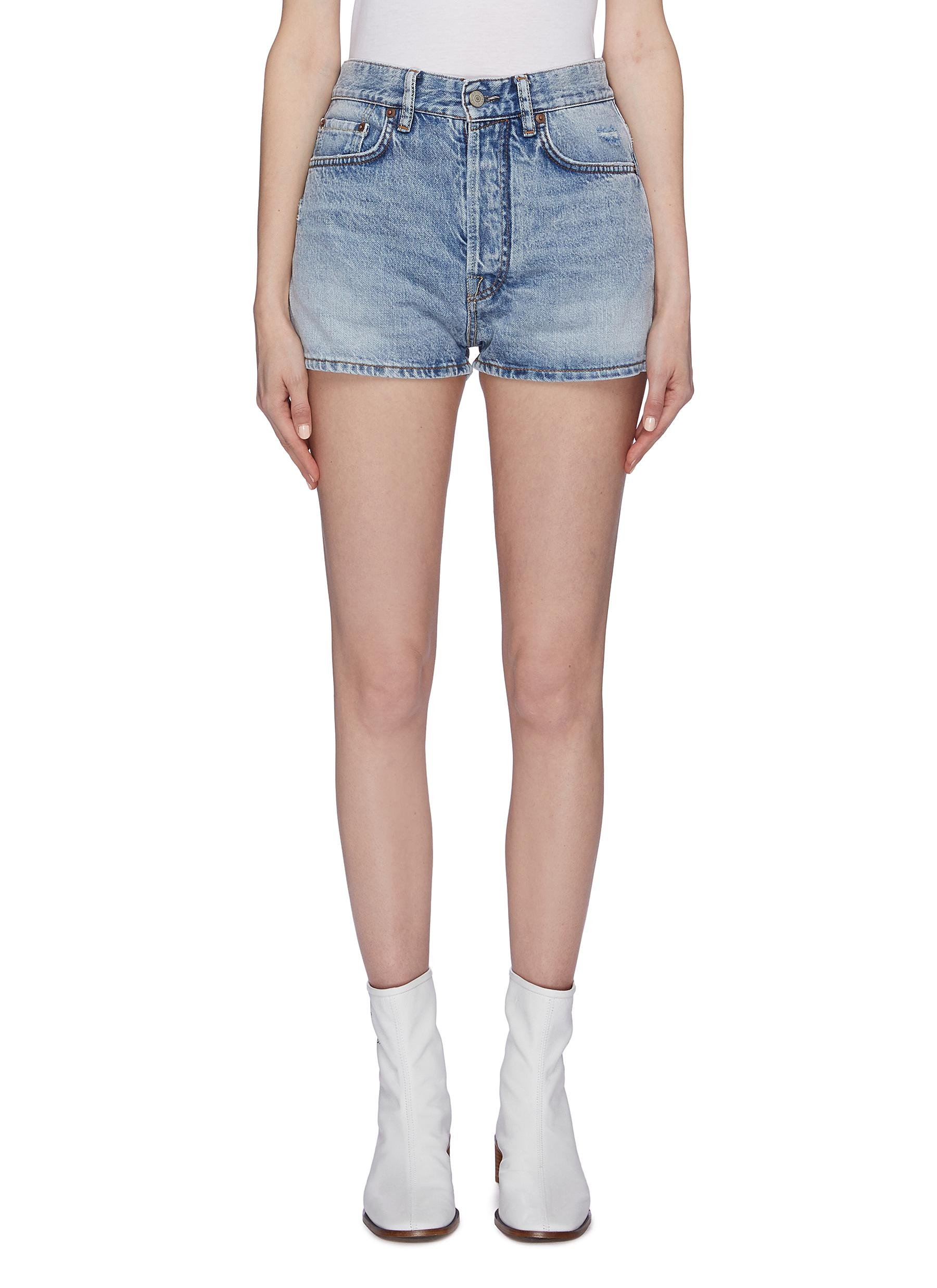 Distressed denim shorts by Acne Studios