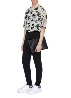 McQ Alexander McQueen Slogan stripe sleeve appliqué swallow print T-shirt