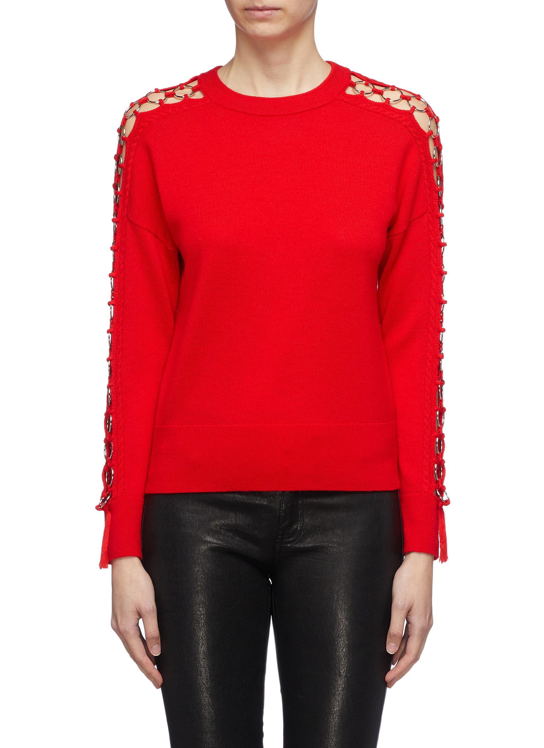 Metal ring cutout sleeve wool sweater by Jonathan Simkhai