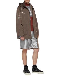 Oakley by Samuel Ross Detachable hood spray paint print jacket