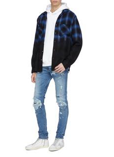 Amiri 'Super Repair' ripped skinny jeans