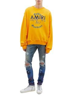 Amiri 'Thrasher' palm tree print ripped slim fit jeans