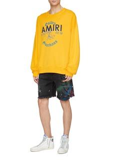 Amiri 'Thrasher' paint splatter print ripped denim shorts