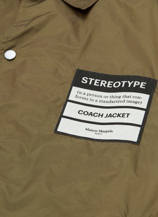 - Maison Margiela - 'Stereotype' appliqué coach jacket