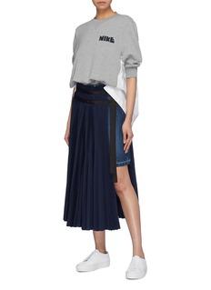 Sacai Asymmetric pleated overlay wrap denim skirt