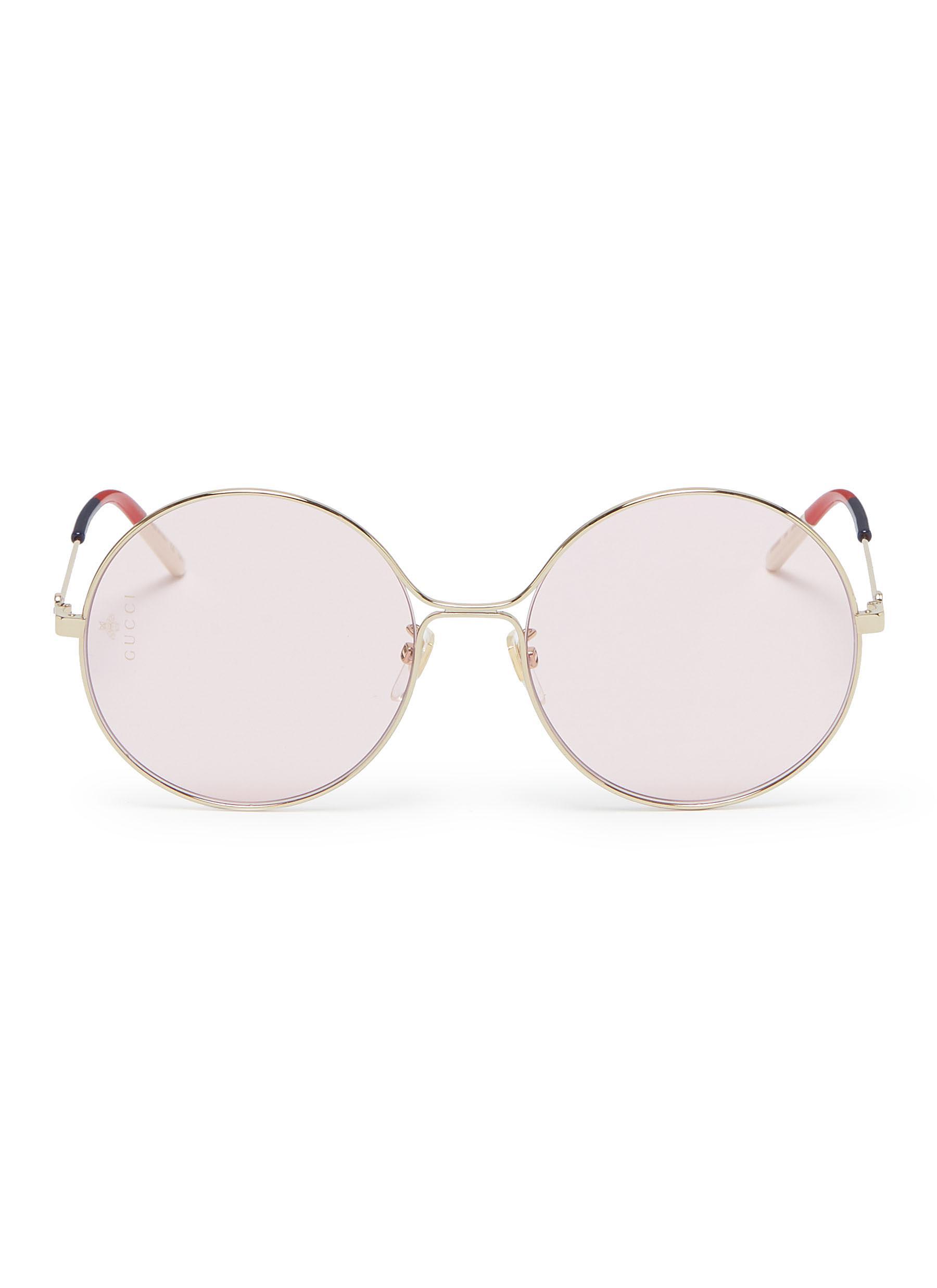 f525efcc9e Gucci. Metal round sunglasses