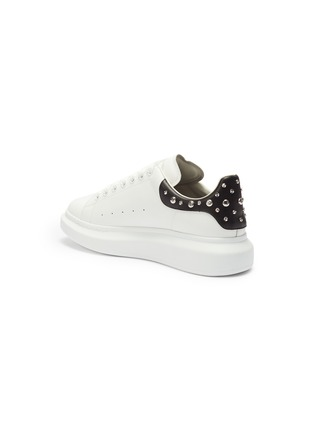 - ALEXANDER MCQUEEN - 'Oversized Sneaker' in leather with stud collar