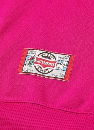 - Vetements - 'Cartoon' slogan graphic print oversized unisex hoodie