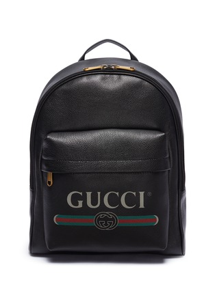 79ece84b50a Gucci Logo print leather backpack