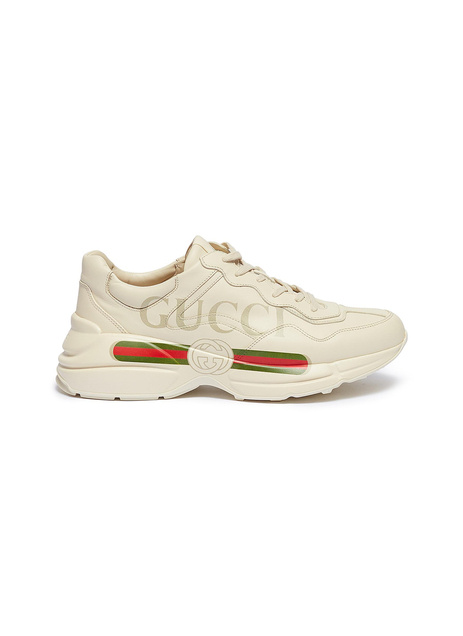 ddc3b5fb083 Gucci.  Rhyton  logo print leather sneakers. Style 221137674