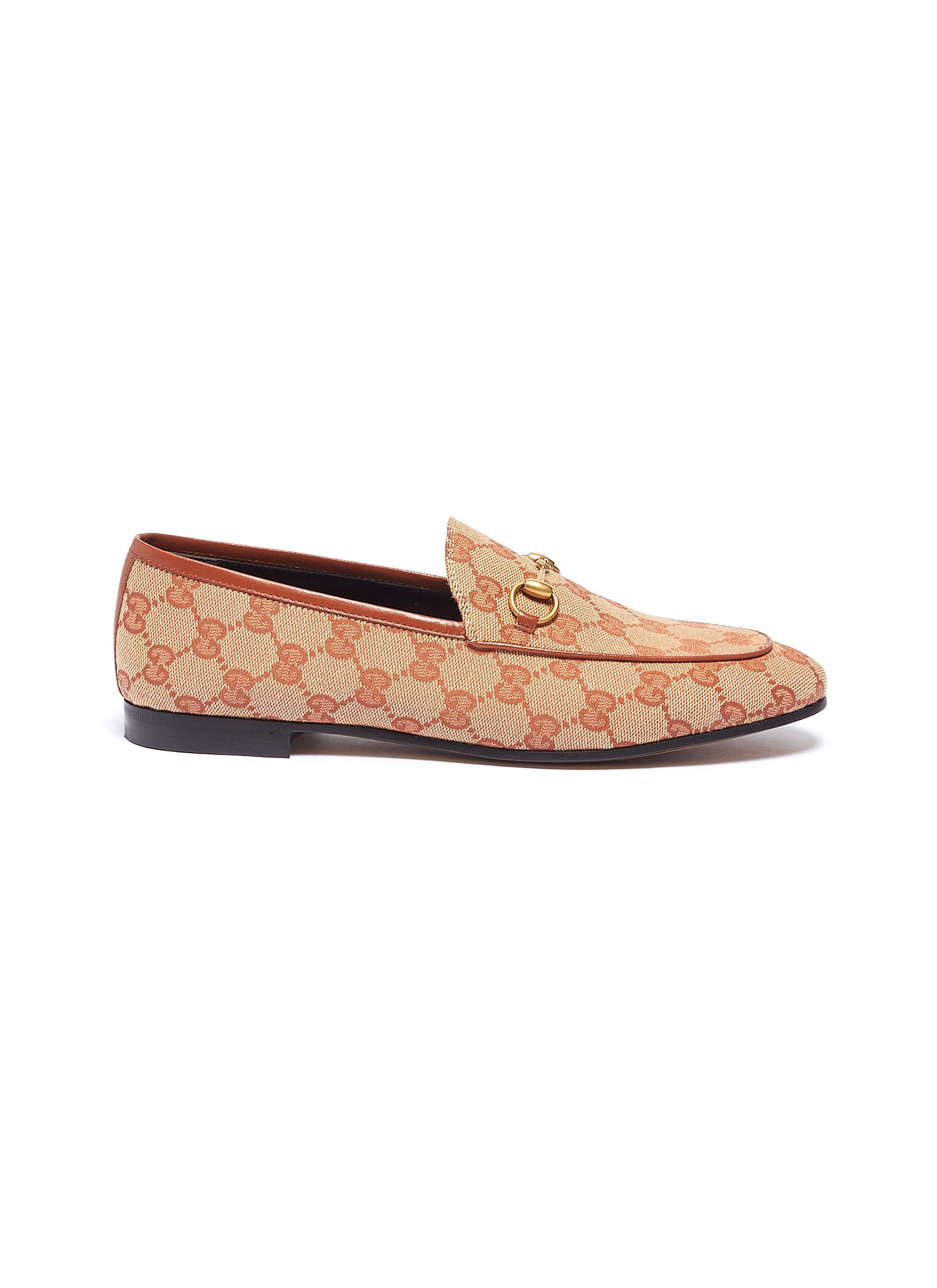25fb576bef9 Gucci.  Jordaan  GG embroidered canvas horsebit loafers