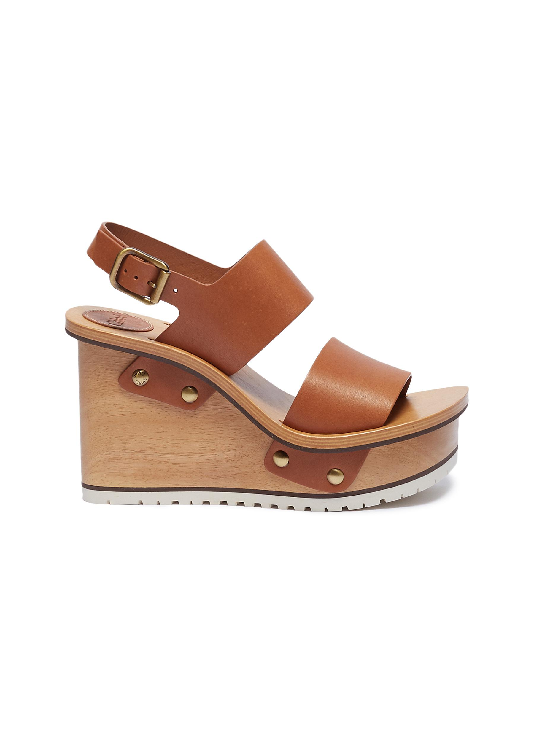 dde548baba3 Chloé. Buckle leather wooden clog wedge sandals
