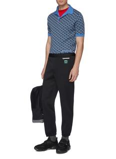 Prada Zip pocket logo patch jersey pants