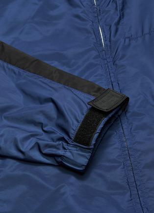 - PRADA - Stripe sleeve hooded windbreaker jacket