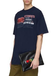 Balenciaga 'Supermarket Clip' slogan print medium leather pouch