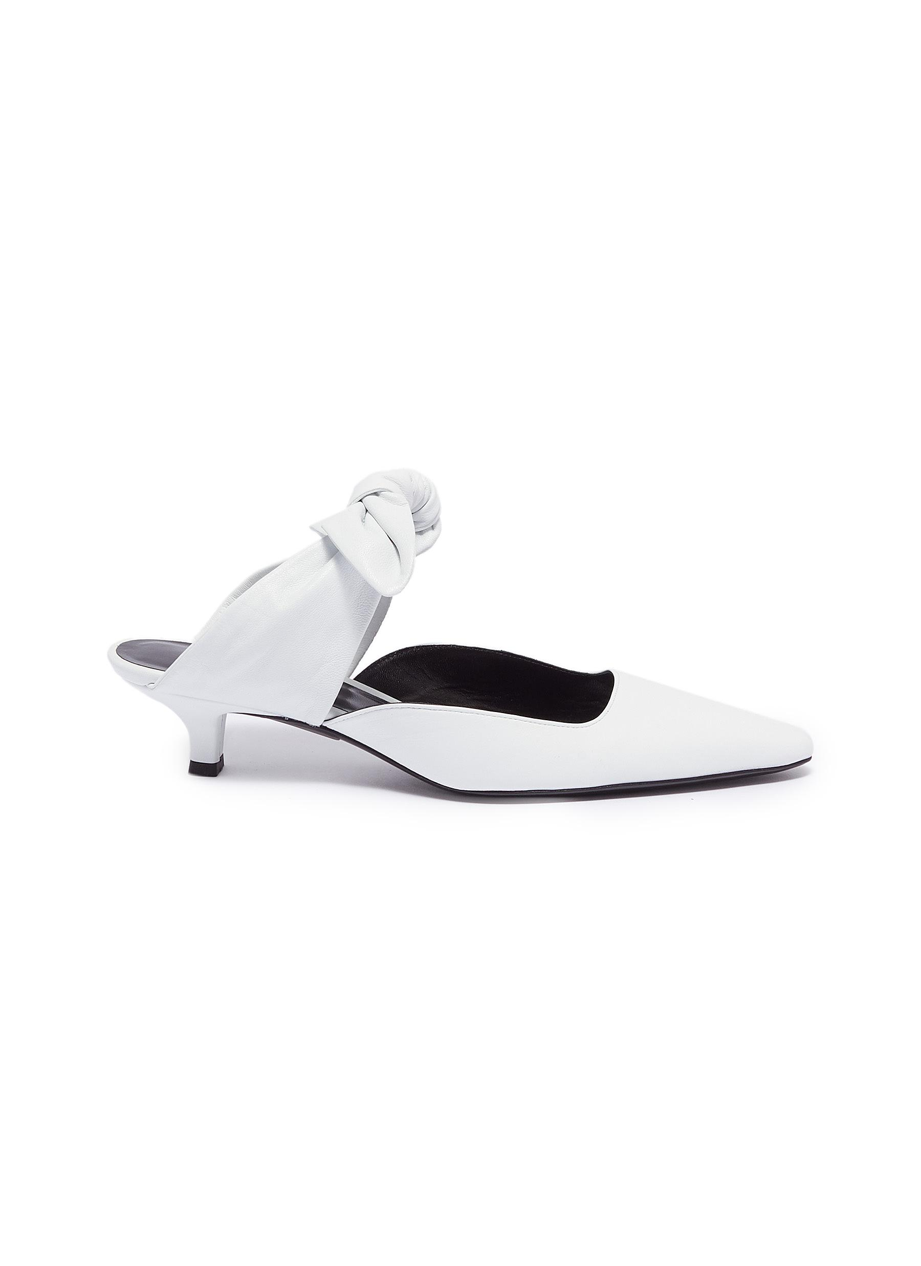 Coco bow tie leather mules by The Row