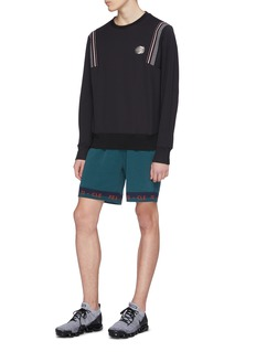 Particle Fever Logo stripe jacquard cuff performance sweat shorts