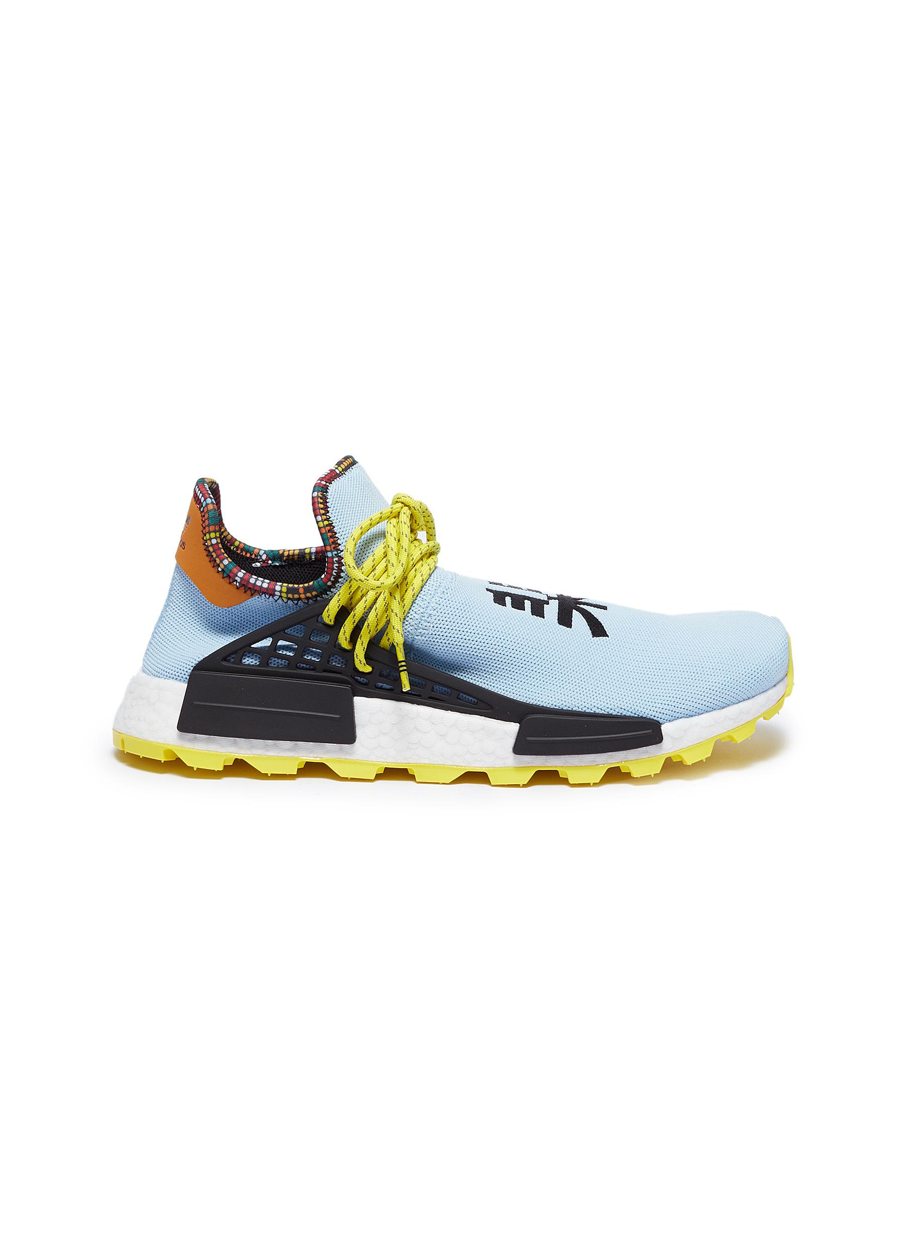2c7fa798d adidas by Pharrell Williams.  SolarHu NMD  slogan embroidered Primeknit  sneakers