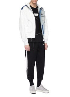 INDICE STUDIO Stripe outseam belted cropped track pants