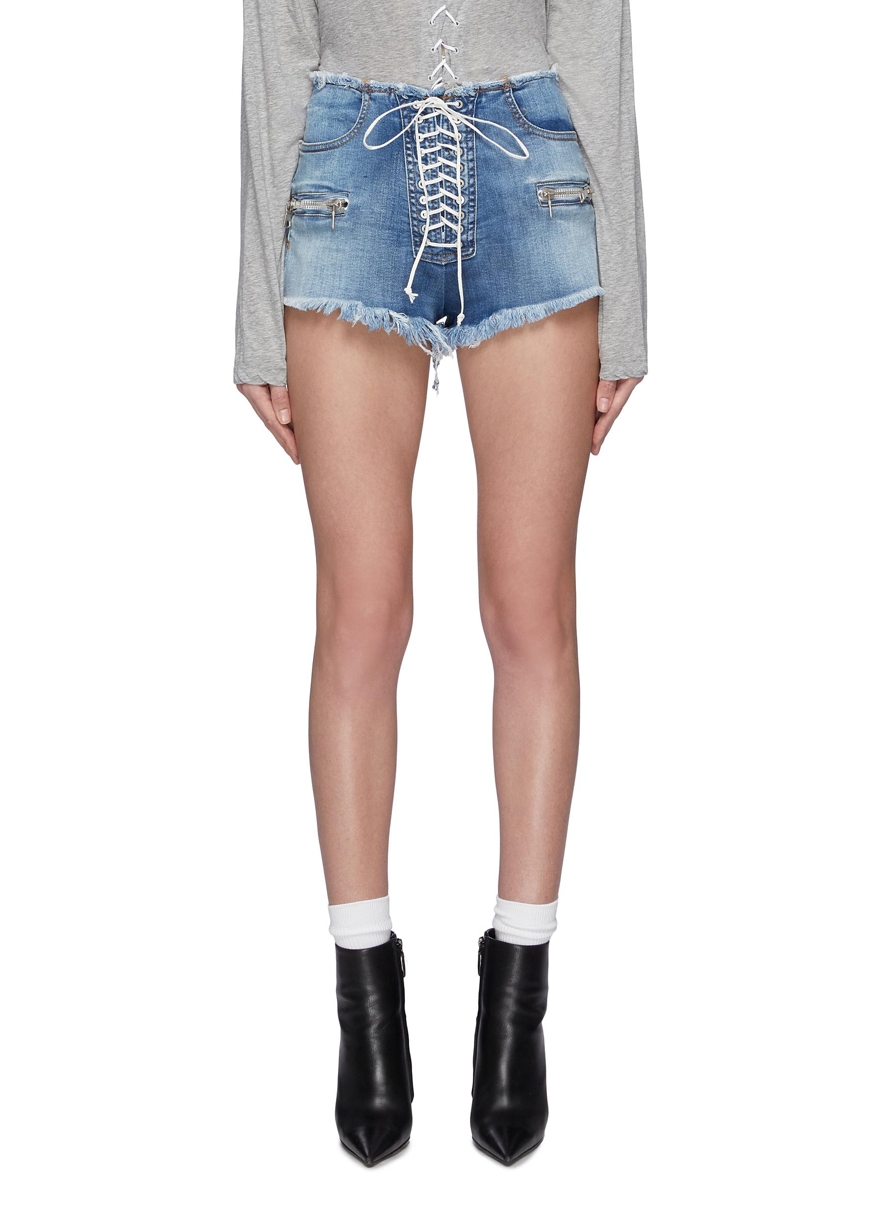 Lace-up frayed denim shorts by Ben Taverniti Unravel Project