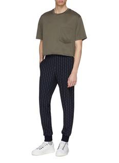 WOOYOUNGMI Logo stripe print tapered leg track pants