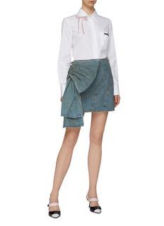 Miu Miu Oversized bow appliqué denim skirt