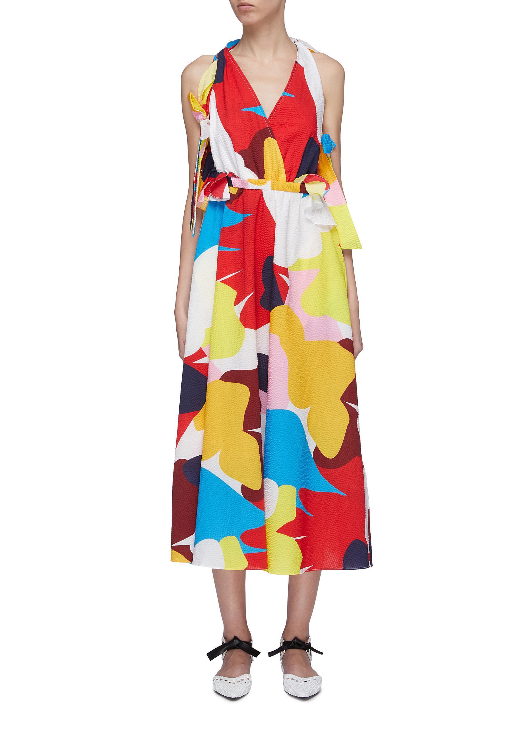 Cutout back bow abstract print dress by Minki