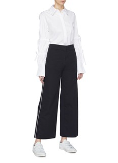 FFIXXED STUDIOS Piped outseam twill flared pants