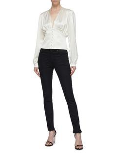 SAINT LAURENT Raw cuff skinny jeans