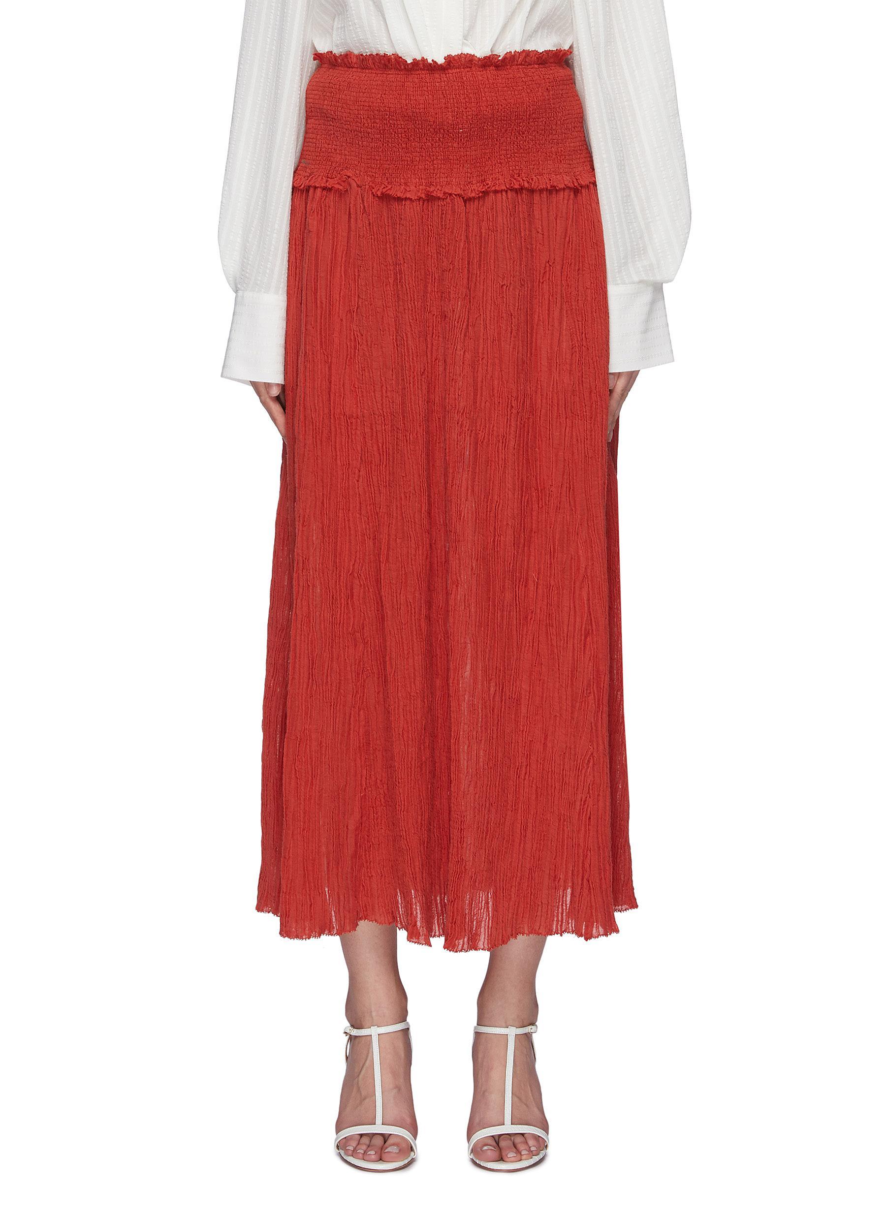 Veneto smocked crinkled midi skirt by Zimmermann