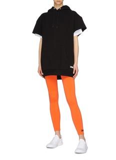 Victoria Beckham x Reebok logo embroidered oversized short sleeve hoodie