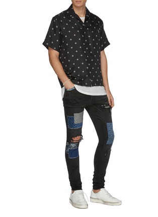 Figure View - Click To Enlarge - AMIRI - Paint splatter print mix patch ripped jeans