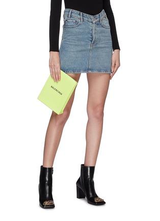 Figure View - Click To Enlarge - BALENCIAGA - 'Shopping' logo print neon leather envelope clutch