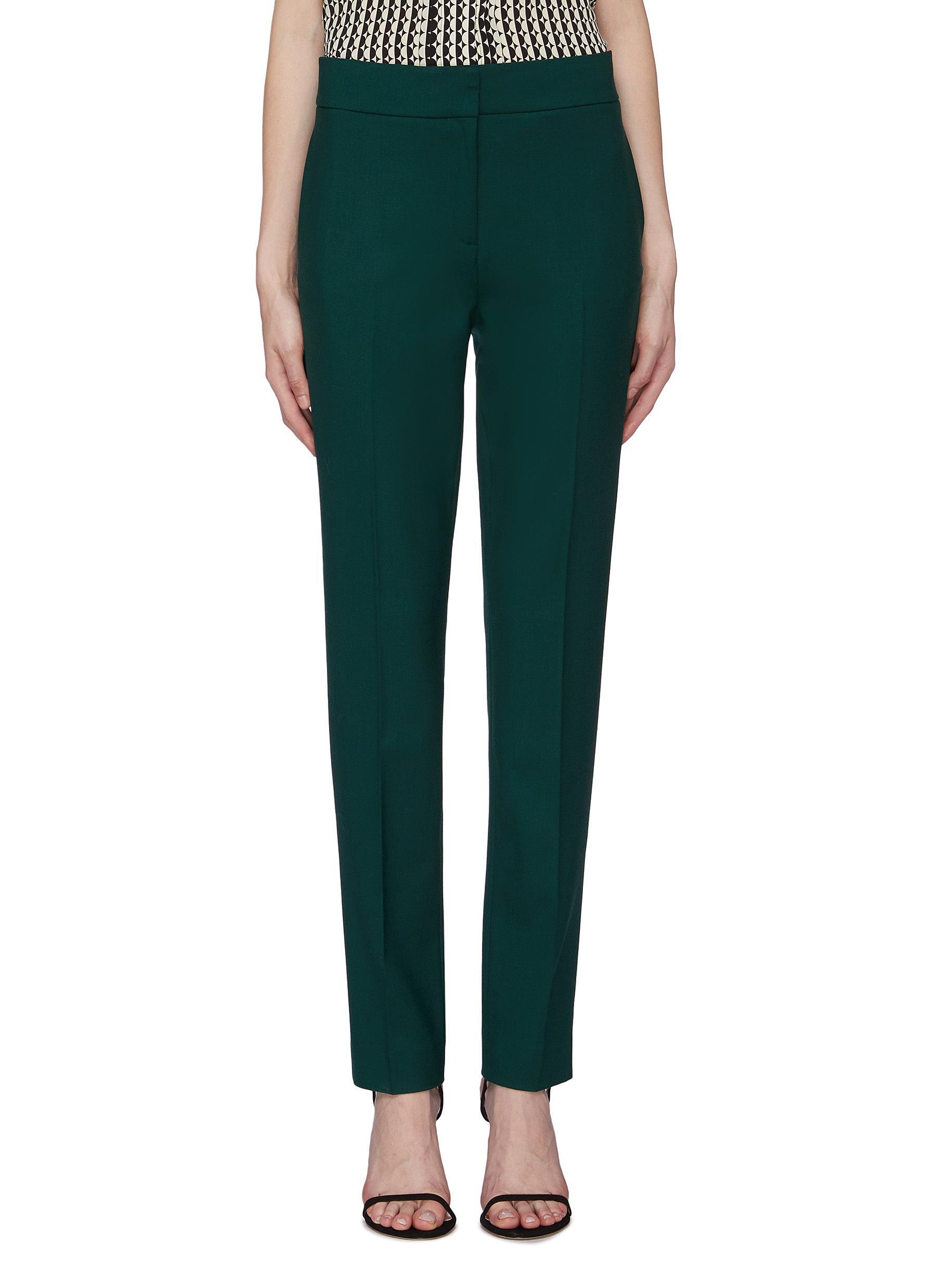 Wool gabardine skinny suiting pants by Oscar De La Renta
